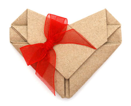 Origami recycle paper heart with bow tie photo