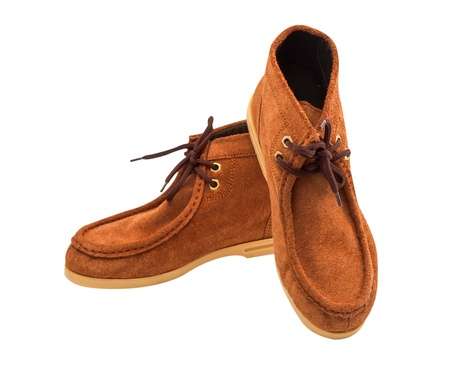 Pair of brown male moccasins over white background photo
