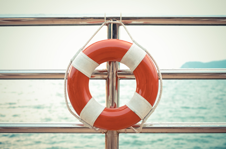 Vintage style photo of life preserver attached to the cruise ship