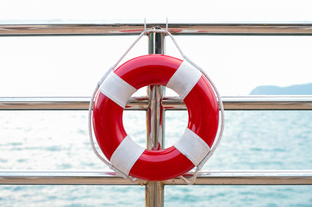 preserver: life preserver attached to the cruise ship