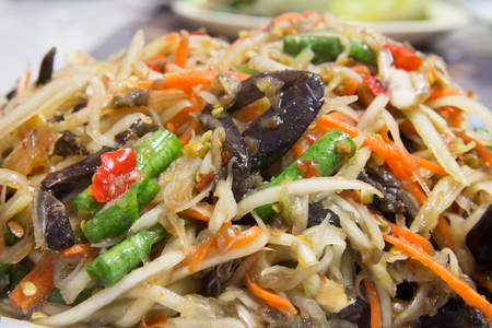 Papaya salad, healthy eating and eating much diarrhea, Popular local cuisine of Thailand. Stock Photo