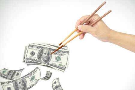 hand clipping dollar money with chopstick Stock Photo - 19193770