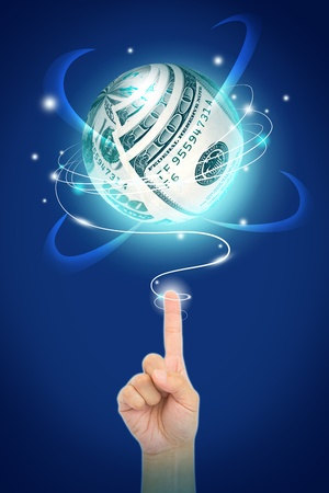 money sphere: dollar money on sphere shape with light over the hand pointing