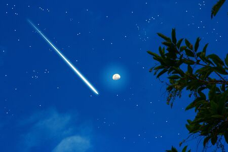 meteoric  on the night sky with star and moon Stock Photo