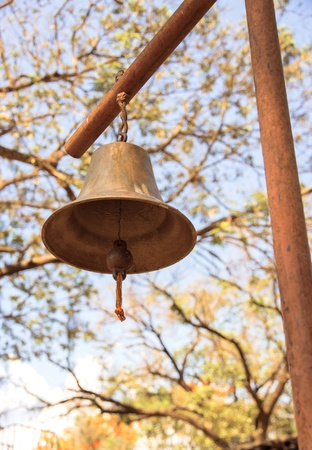 antique old metal bell on the pole