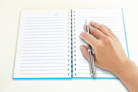 Hand write with pen on  notebook Stock Photo - 19792842