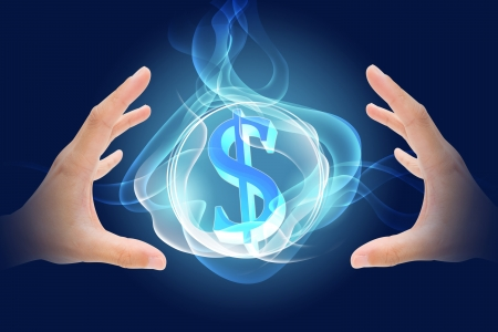 dollar symbol growing in between hands holding Stock Photo