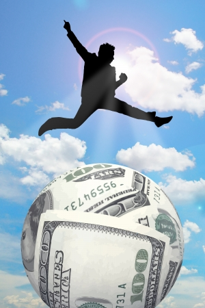 money sphere: silhouette businessman jump over money sphere