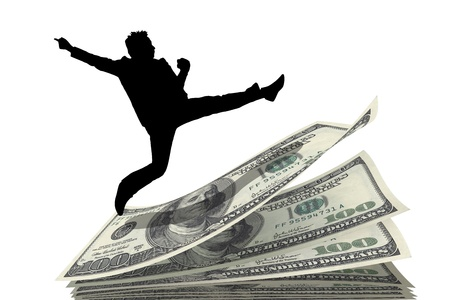 silhouette businessman jump over  pile of money Stock Photo - 20643523