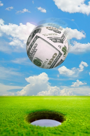 money sphere shoot in golf hole,make score,business concept photo