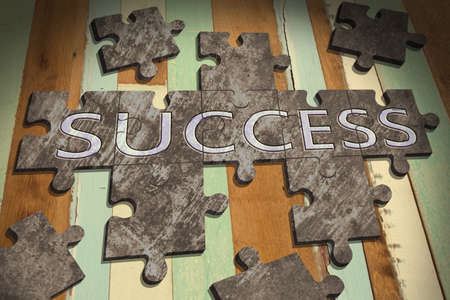 success concept with  jigsaw puzzle on wooden table background,business concept Stock Photo - 21806681