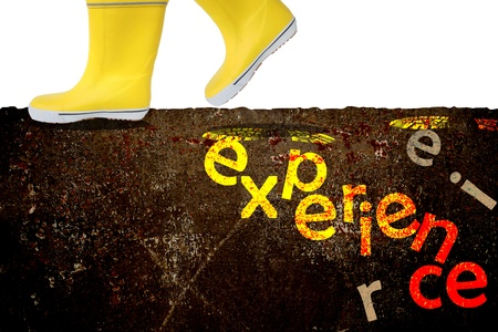 yellow boots walk on ground for more experience,business concept