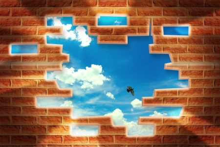 collapsed: Broken Brick Wall with beautiful landscape behind Stock Photo