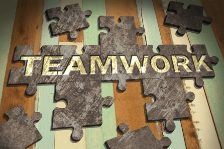teamwork concept with  jigsaw puzzle on wooden table background,business concept Stock Photo - 21806860