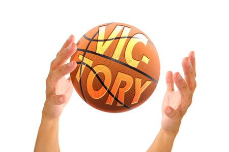 it business: hand holding basketball with text victory on it, business concept