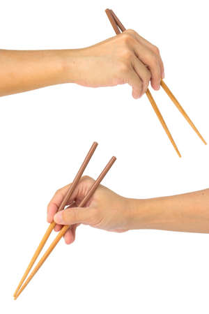 Hand holds the chopsticks, isolated on white background Stock Photo