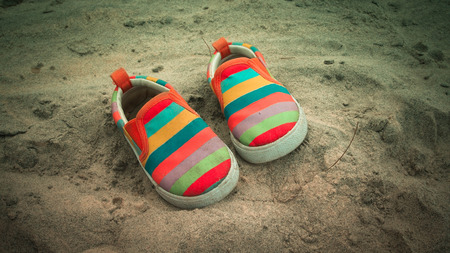 swimming shoes: colorful shoes on sand beach