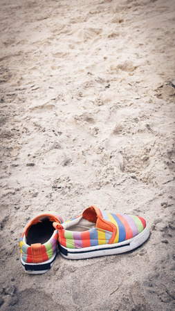 swim shoes: colorful shoes on sand beach