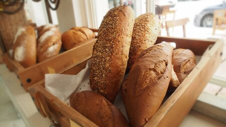 breadbasket: Bread  in basket on shelf in bakery or bakers shop