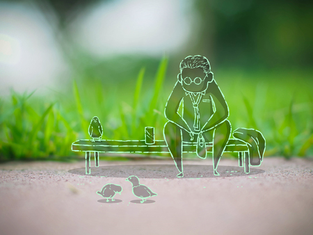 Drawing of a man sitting relax and feeding birds in a park, illustration mixed with photograph style, lifestyle concept Stock Photo