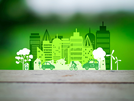 responsibility: Ecology concept ;green car with windmill  in the city in Paper Cut Style on white background,Ecology concept art Stock Photo