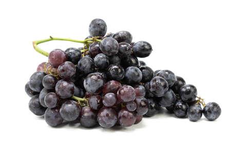 Fresh black grapes on isolated white background