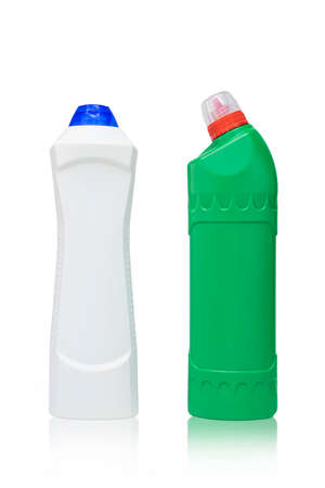 Green and white detergent bottles on isolated white background. Cleaning agents mock up.