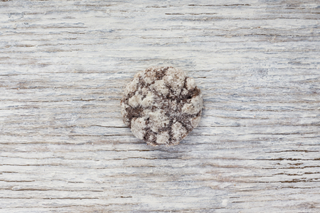 bickie: Chocolate cookies on light wooden background