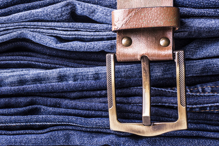 Jeans background. Texture. Leather belt 版權商用圖片