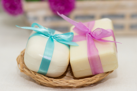 two pieces: Two pieces of soap with a basket with  bows
