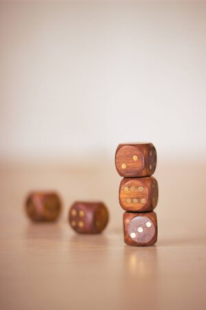 woden: Five woden dices on light beige wooden table