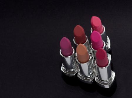 black makeup: Assorted matte lipsticks on black background