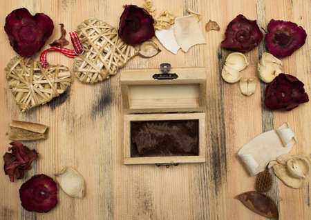 herbs boxes: Gift box straw heart and a herbarium on a background of a wooden table Stock Photo
