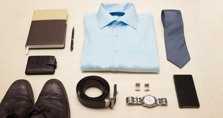 shirt and tie: Mens classic office outfit with blue shirt, tie and accessories Stock Photo