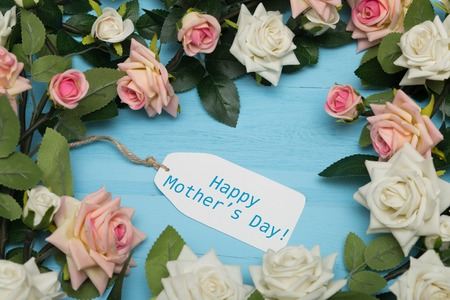 gratefulness: Mothers day card with rustic roses on blue wooden background