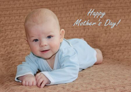 four month: Cute four month baby boy  on bed, mothers day concept