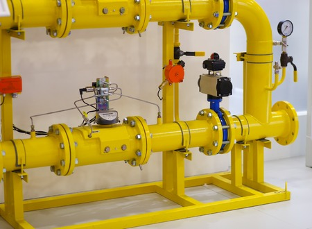 Close up of yellow barometer in natural gas production industry