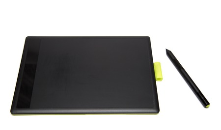 wacom: Top view of modern graphic tablet with pen isolated on white background Stock Photo