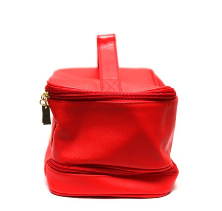 leasure: Red leasure make up bag isolated on white background, profile view