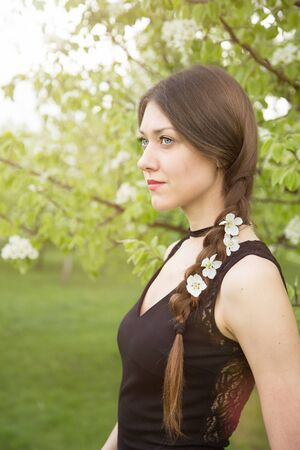 tress: Close up view of young womans tress with cherry flowers within