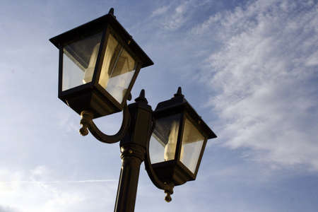classic black lamposts against blue sky Stok Fotoğraf