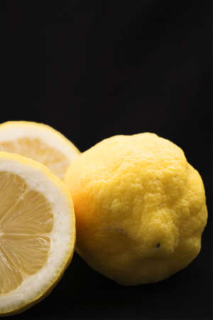 parted and whole lemon  写真素材