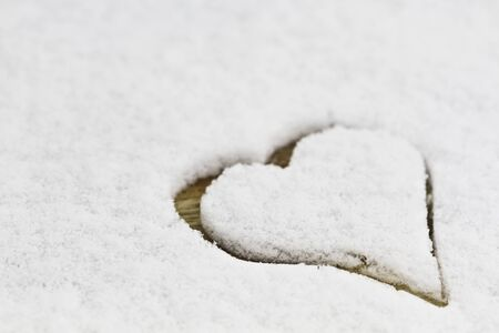 White snow with drown heart shape on wooden background  Stock Photo - 16900738