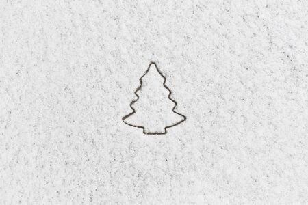 White snow with drown christmas tree  shape on wooden background  Stock Photo - 16900744