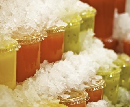 colorful slushy ice drinks in plastic cups