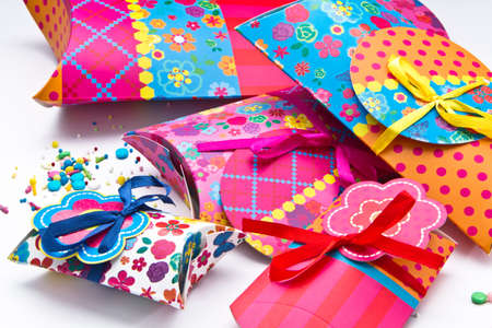 colorful gift boxes with ribbons and bows. Isolated on white background