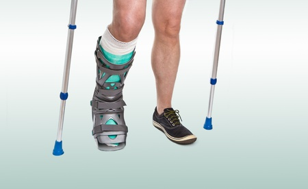 broken foot: Man with a broken leg with Crutches and bandage