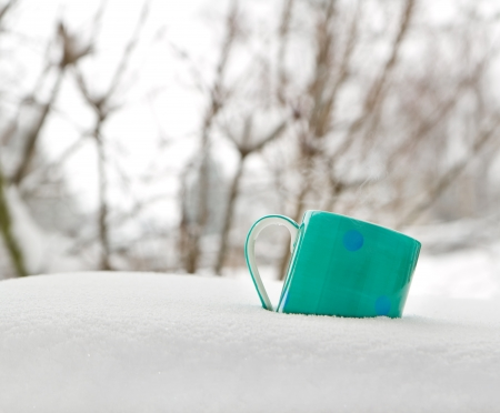 Cup of hot drink outdoors in the snowy winter Stock Photo - 18082530