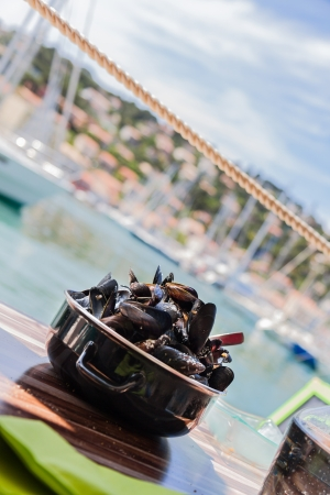 molluscs: Mussels in french outdoor restaurant with Mediterranean sea view