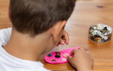 art therapy: boy sewing